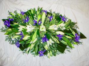 White Oriental Lilies Longi Lilies and Mixed Foliage Coffin Arrangement