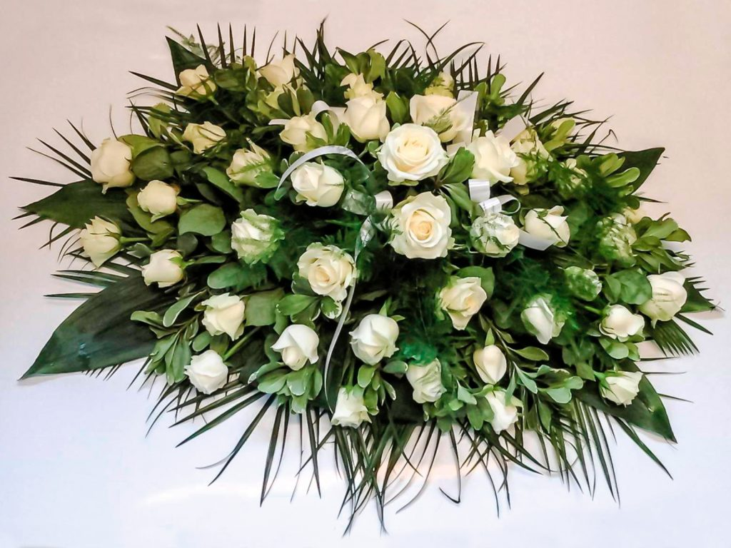 White Roses and Mixed Foliage Coffin Arrangement
