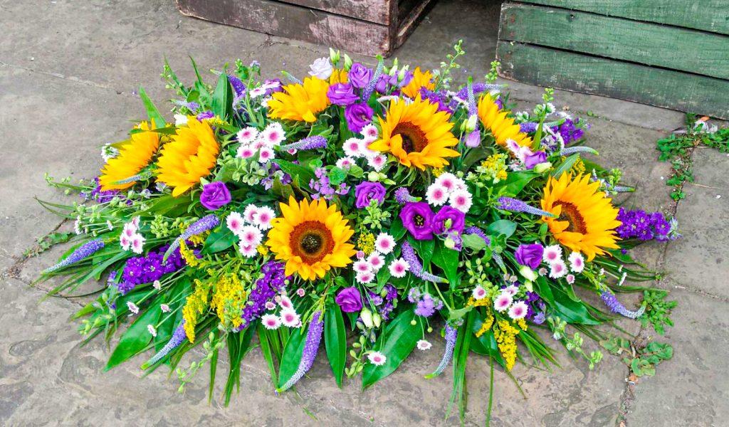 Stunning Sunflowers, Lisianthus, Purple Coffin Arrangement