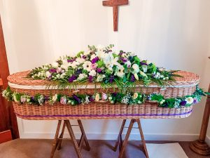 White Coffin Arrangement with Shades of Lilac, Purple