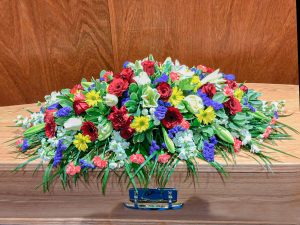 Vibrant Bright Coffin Arrangement in Reds Purples, Oranges and Yellows