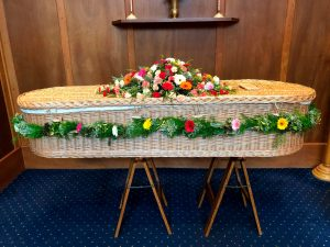 Brightly Coloured Coffin Arrangement using Gerbera and Carnations