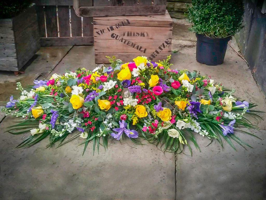 Vibrant Spring Coloured Coffin Arrangement, Florist, Radcliffe