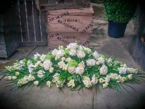 White and Green Classic Coffin Arrangement