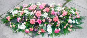 White Coffin Arrangement With Pink Roses And Pink Carnations