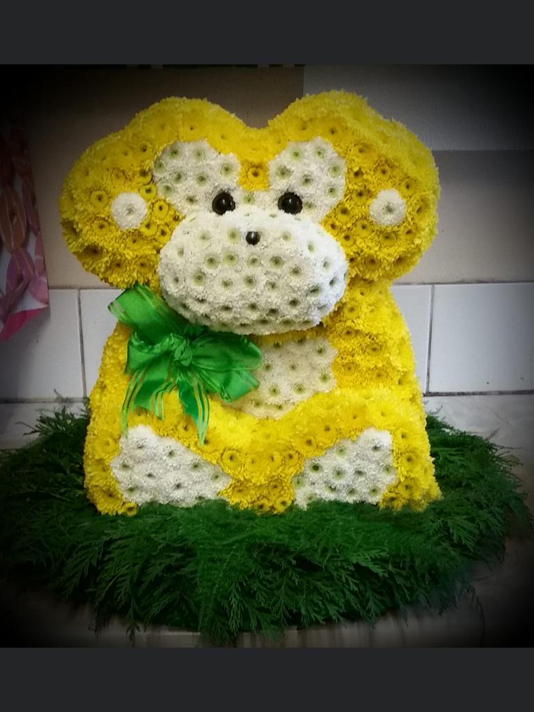 Funeral, monkey in flowers, Bury, Radcliffe